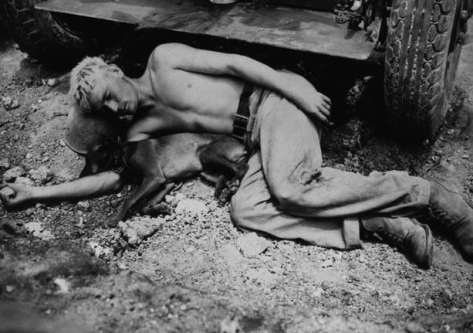 1945, Japan, Okinawa. A soldier and his pet dog.