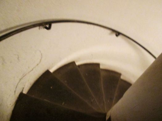 A spiral staircase taking us 20 meters underground into the Catacombs of Paris
