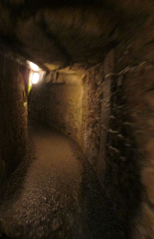 A tunnel underground, Catacombs of Paris, where life is suddenly a precious commodity.