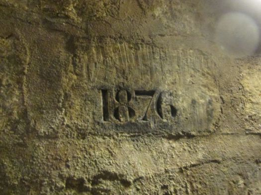 1876 stamped in a brick: , Catacombs of Paris officially opened to the public.
