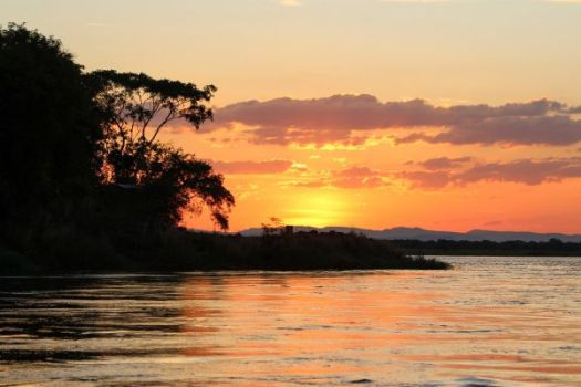 Why Rhino is Grumpy and Hippo is Mad at Hare. sunet over Zambezi River