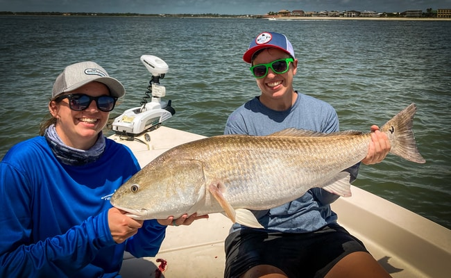 couple with redfish caught using trolling motor