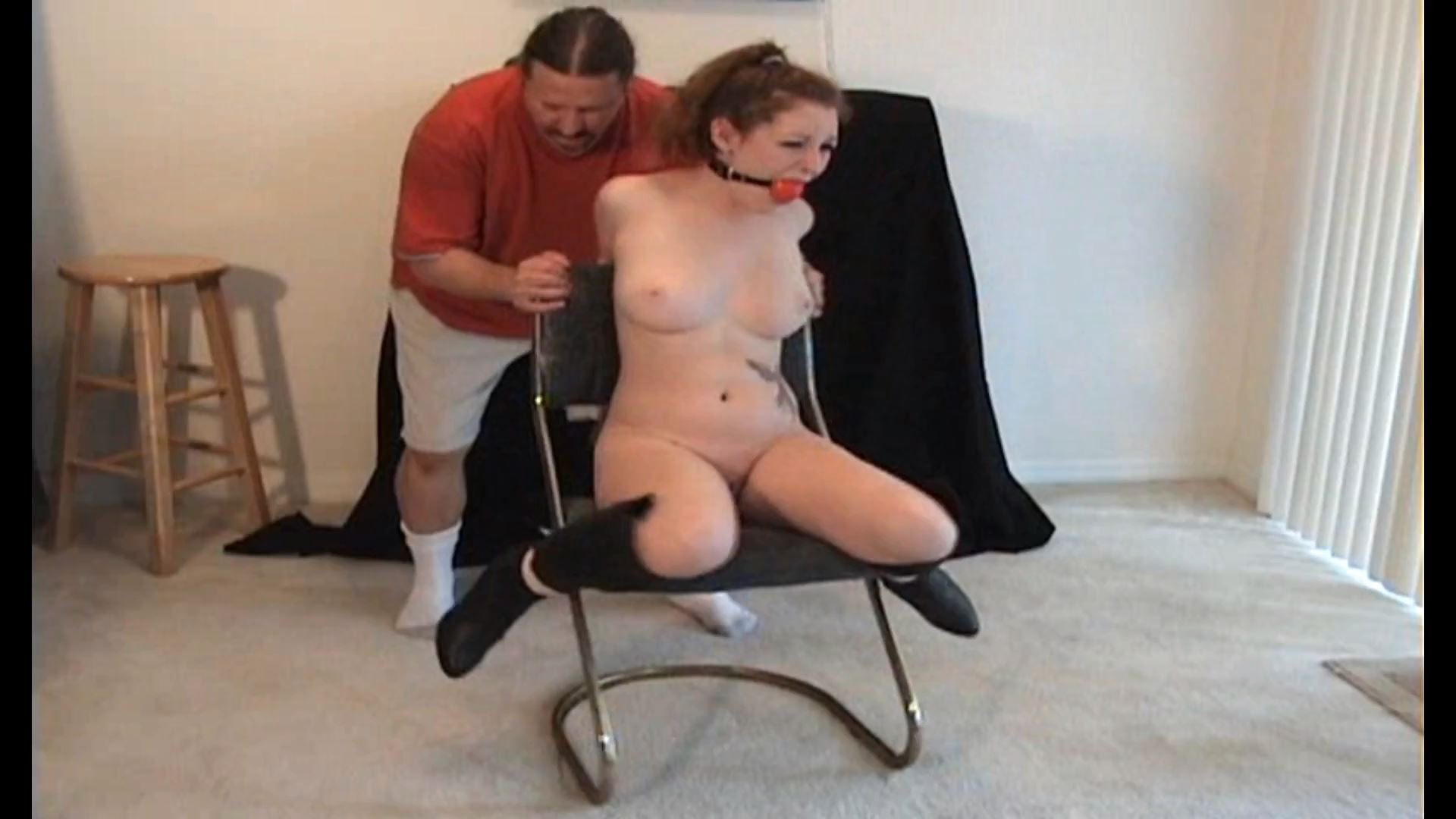 Topless girl tied to chair  Porn galleries