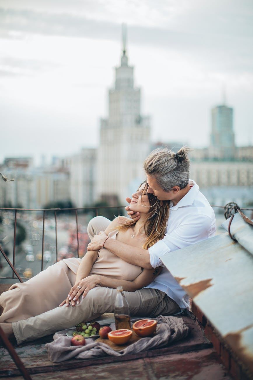 loving couple embracing on rooftop during date