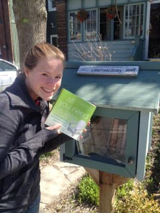Kris dropping a copy off at a Little Free Library in Toronto, Ontario.