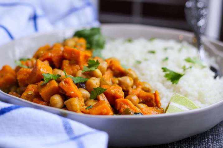"Vegan Sweet Potato and Chickpea Curry Over Cauliflower ""Rice"""