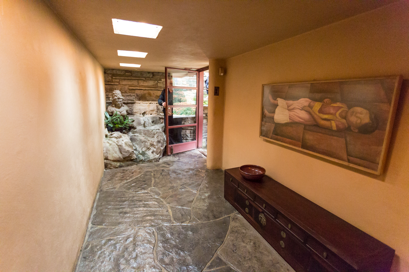Hallway with indoor waterfall and original Diego Rivera painting