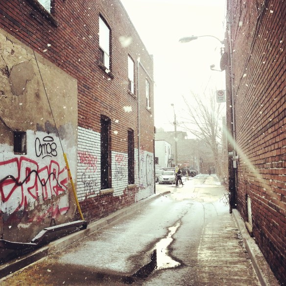 Snow falling in alley