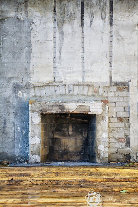 Fireplace in partially demolished home