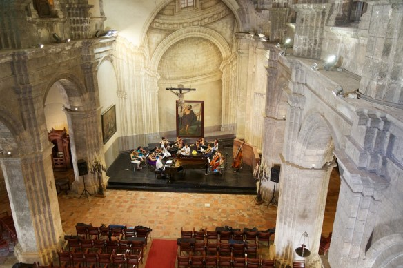 Orchestra rehearsing in church