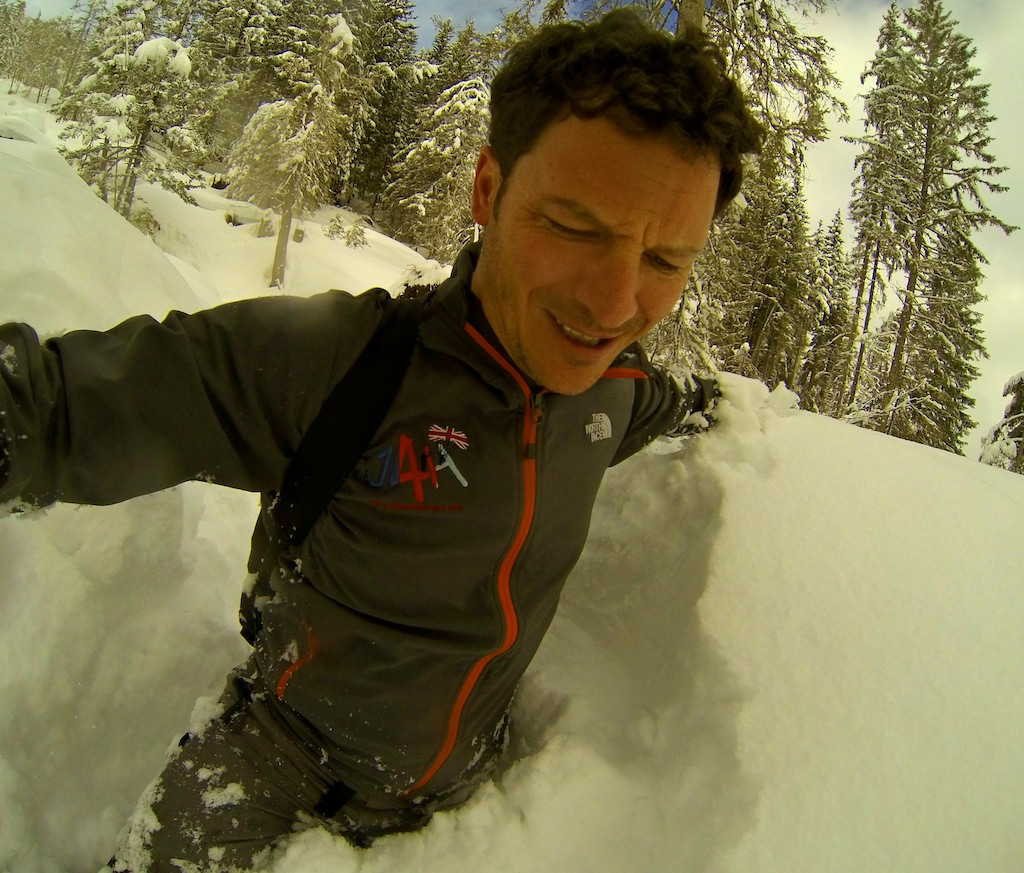 Battling through the chest-deep snow to get to the exit point for a wingsuit proximity BASE jump.