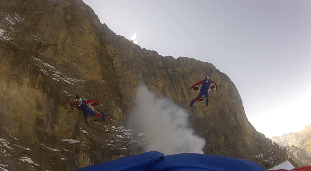 A 3 way wingsuit human flight formation from the north face of the Eiger.