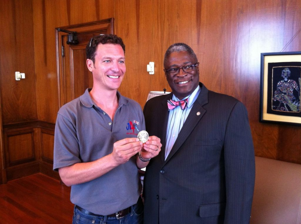 Mayor Sly James presenting the Mayor's Challenge Coin to Alastair Macartney after his leap from the World War One Museum in Kansas City.
