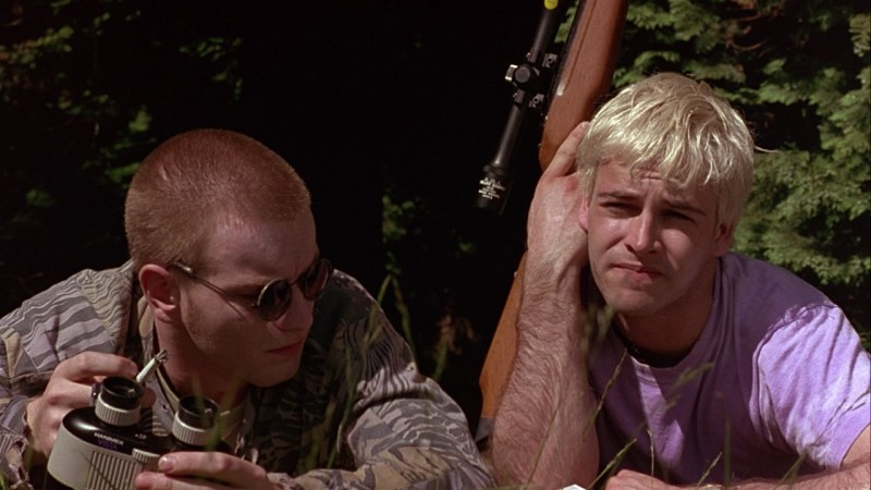 Ewan McGregor and Jonny Lee Miller with an air rifle in the park in the film Trainspotting (1996)