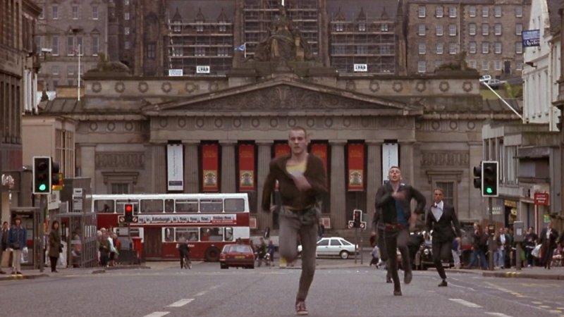 Ewan McGregor and Ewen Bremner running down Princes Street onto Hanover Street in the film Trainspotting (1996)
