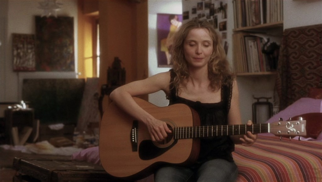 Before Sunset (2004) film still of Celine playing guitar in her Paris apartment