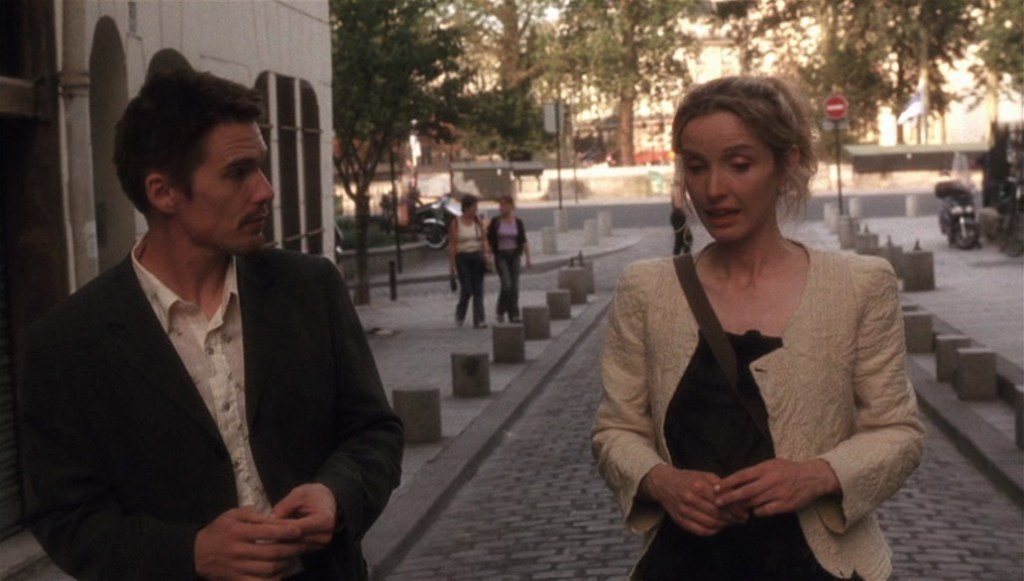 Before Sunset (2004) film still of Celine and Jesse walking down a Paris street