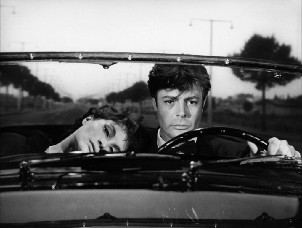 Emma and Marcello in the car in Rome, Italy, one of the La Dolce Vita filming locations