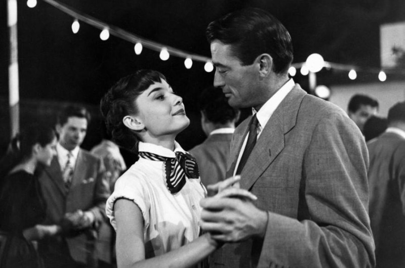 Anne and Joe dancing on a barge outside Castel Sant'Angelo, Rome in Roman Holiday (1953)