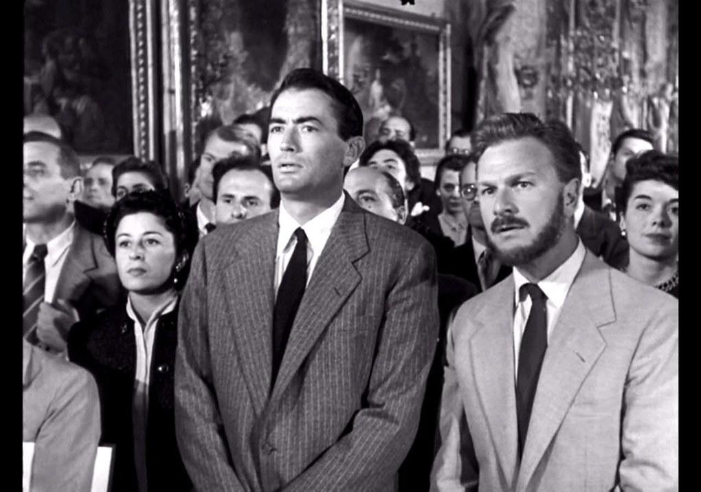 Joe in the Princess' press conference in Roman Holiday (1953)