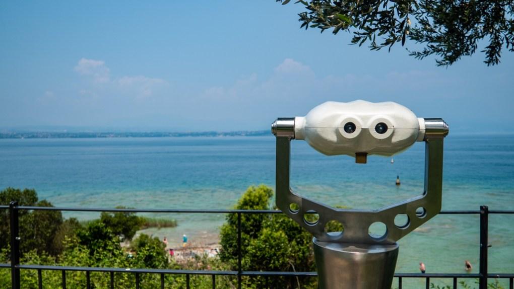Binoculars across Lake Garda from Sirmione, Italy