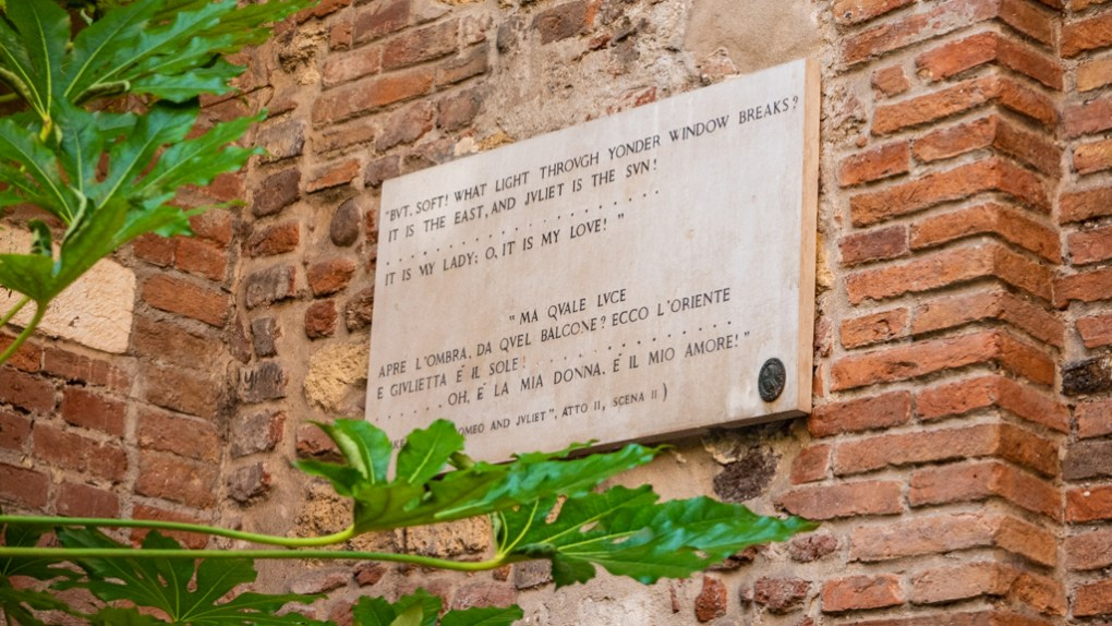 Quote on a plaque from the play Romeo and Juliet in the Casa di Giulietta Courtyard in Verona, Italy