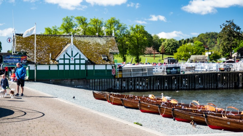 Ticket office, jetty and sail boats in Bowness-On-Windermere in the Lake District, UK