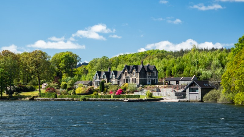 Mansion on an island in Lake Windermere in Bowness-On-Windermere in the Lake District, UK