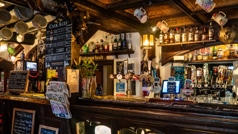 The bar inside Hole in t' Wall pub in Bowness-On-Windermere in the Lake District, UK