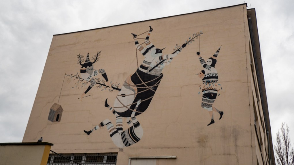 Large mural street art of warriors attacking something in Wrocław, Poland, how to spend 48 Hours in Wrocław, Poland
