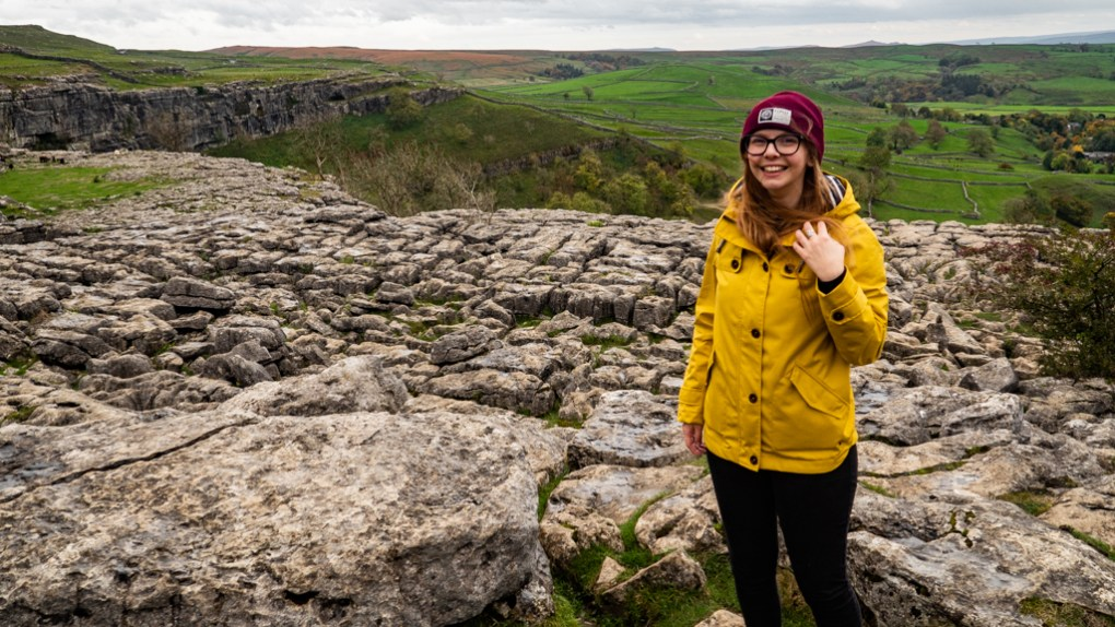 Almost Ginger blog owner on the Limestone Pavement at Malham Cove, a Harry Potter Filming Location in the Yorkshire Dales