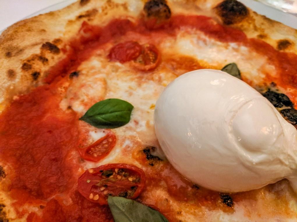Buffalo Mozzarella pizza in Green Tower Pizzaria in Trento, Italy