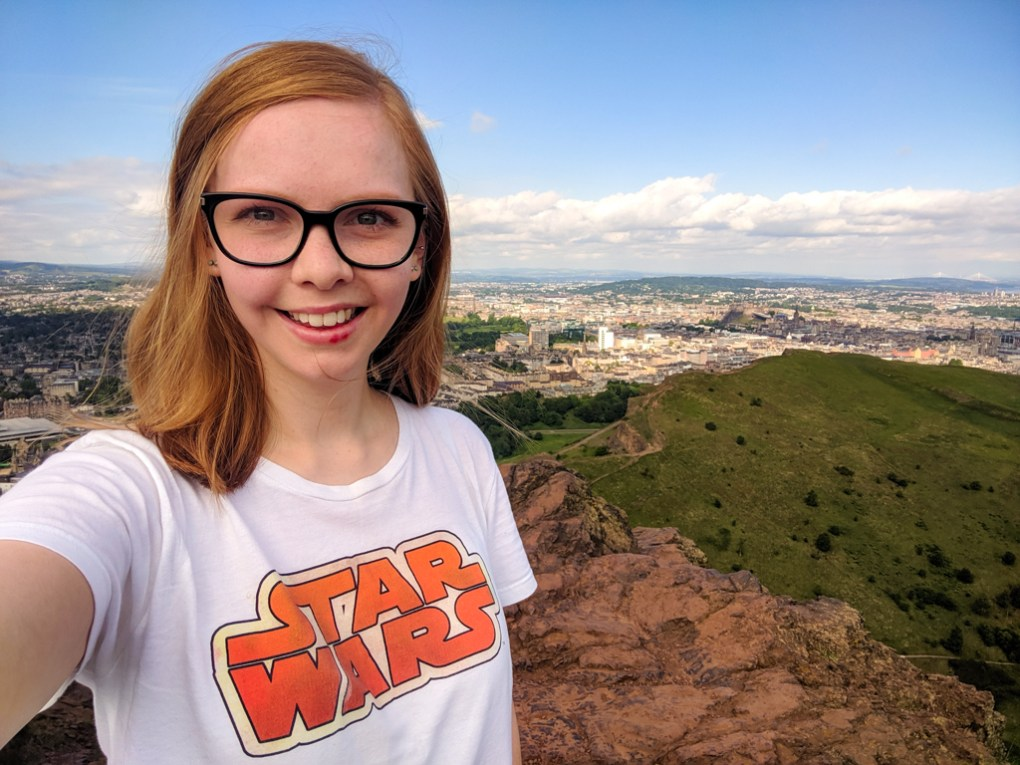 Almost Ginger blog owner on top of Arthur's Seat in Edinburgh, Scotland