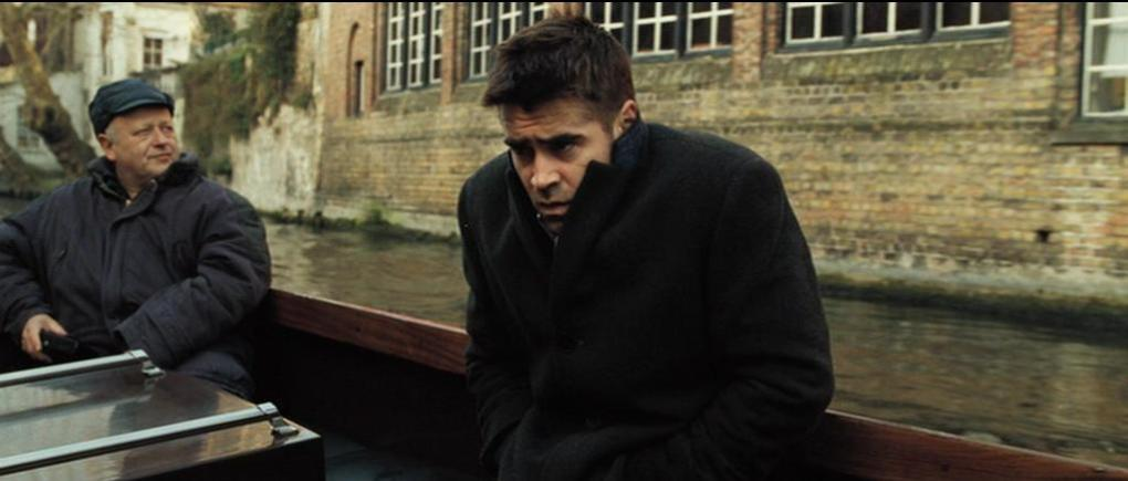 Ray (Colin Farrell) on a canal boat one of the In Bruges filming locations