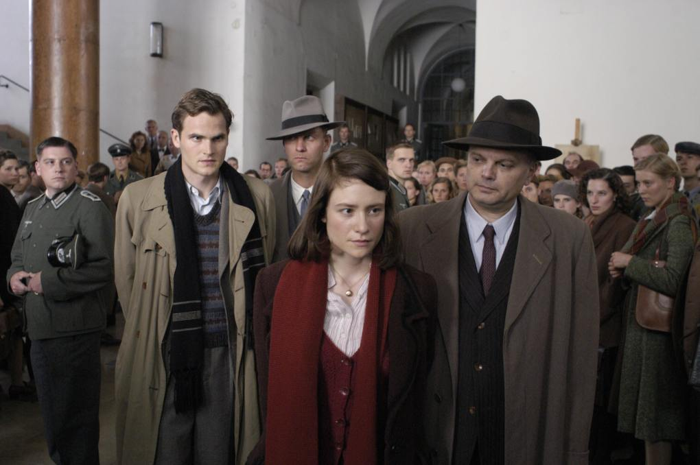 Film still from Sophie Scholl: The Final Days (2005) of two prisoners outside a courtroom