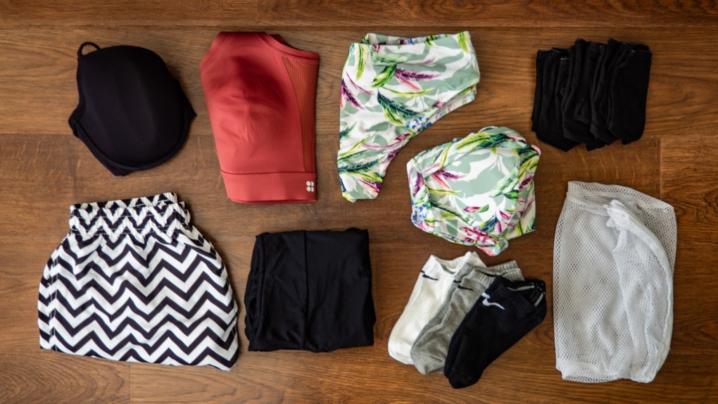 Flatlay of swimwear and underwear to pack for summer camp