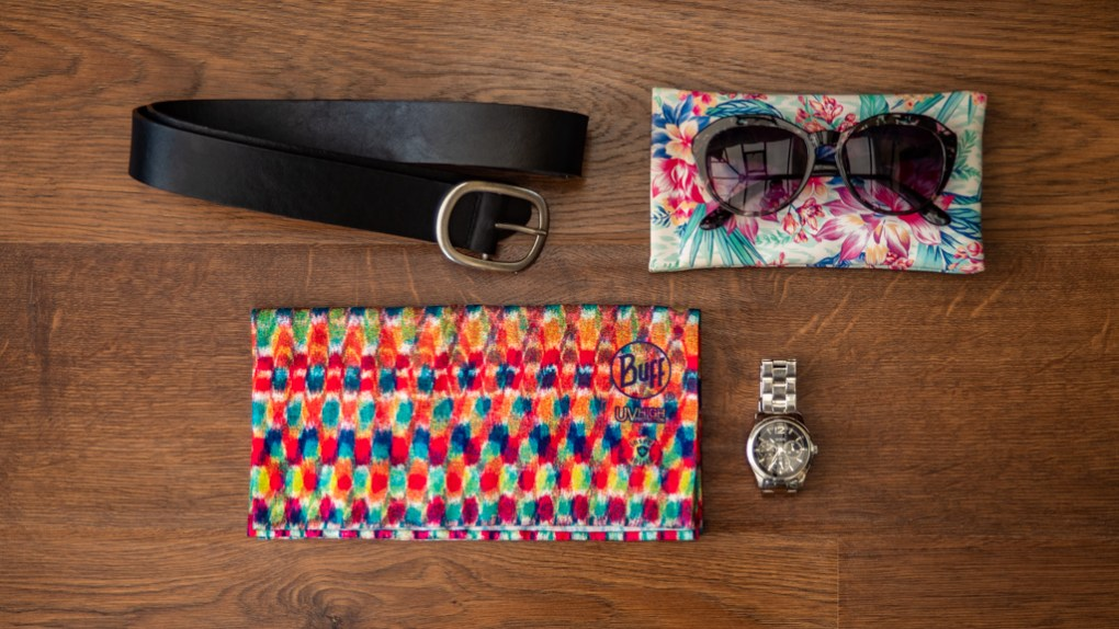 Flatlay of accessories for camp counsellors to pack for summer camp