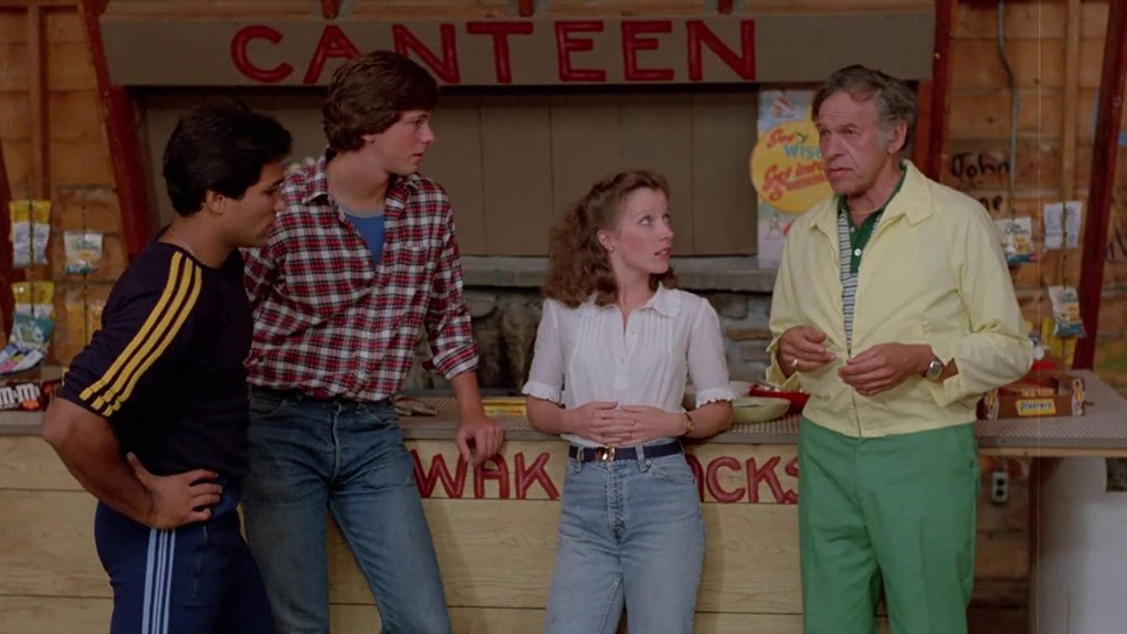 Sleepaway Camp/Nightmare Vacation (1983) film still featuring three camp counsellors and camp director standing by the snack stall