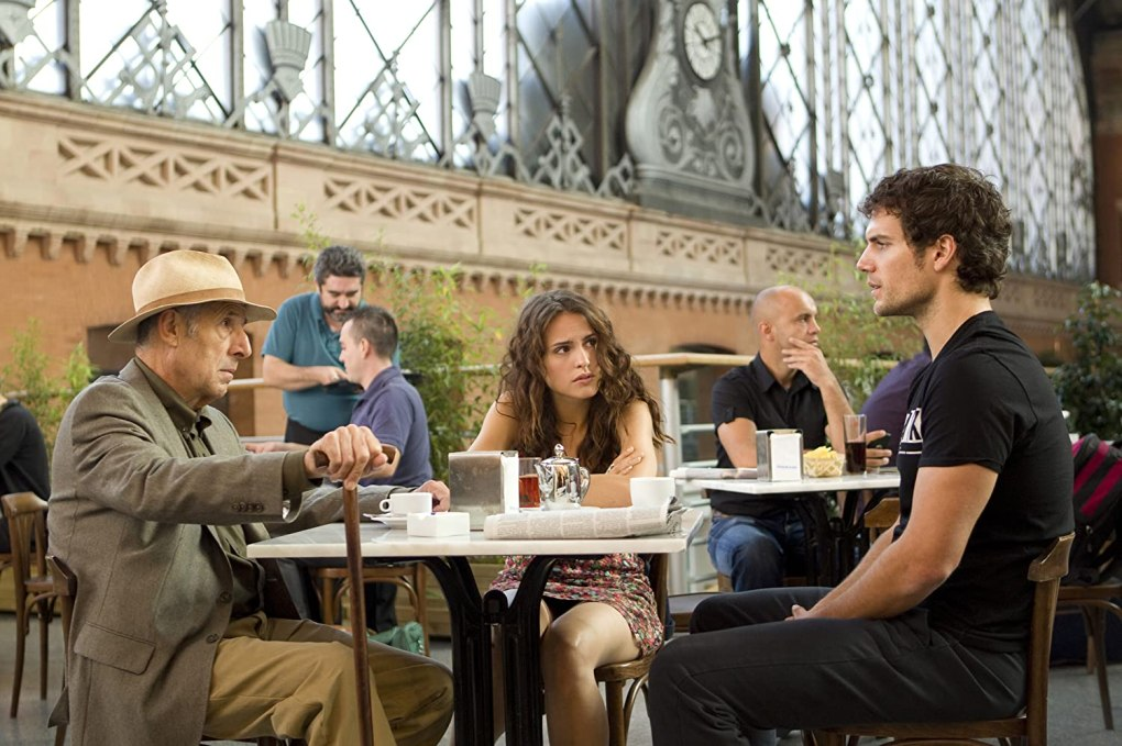 The Cold Light of Day (2012) film still of Henry Cavill and two others dining outside in Madrid, Spain