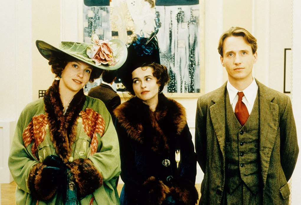 The Wings of the Dove (1997) film still of three people dressed in 1920s clothing