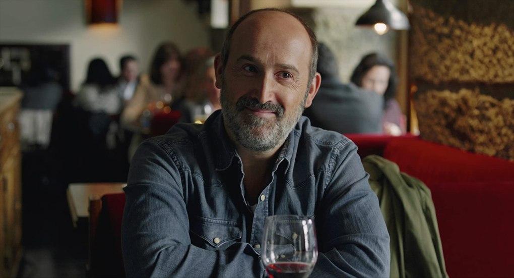 Truman (2015) film still of a man drinking red wine in a restaurant