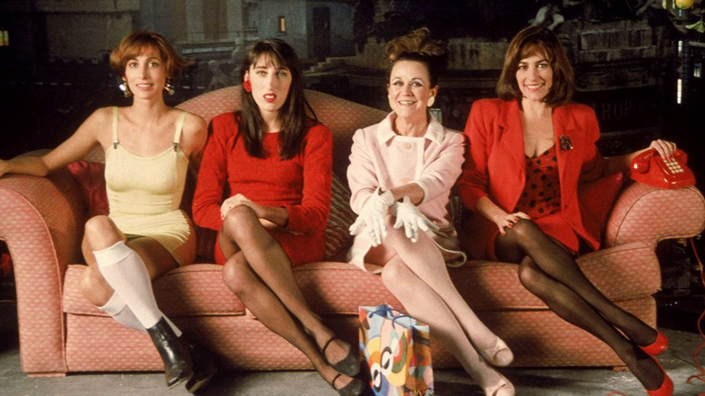 Woman on the Verge of a Nervous Breakdown (1988) film still of four woman cross-legged on a sofa