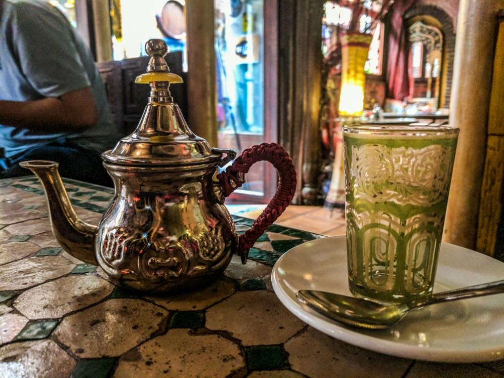 Moorish teapot and glass in a tea shop in Granada, Spain