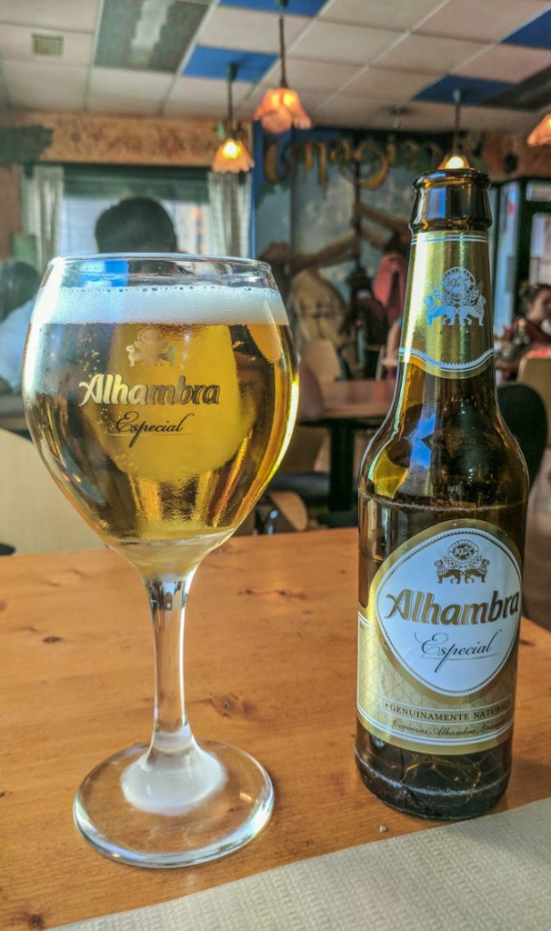 Bottle of Alhambra beer with glass in a restaurant in Granada, Spain