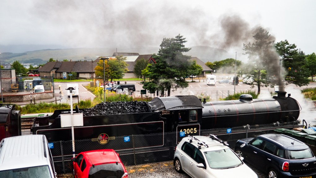 View of Jacobite Steam Train at Fort William Station from Apartment Window, Scotland