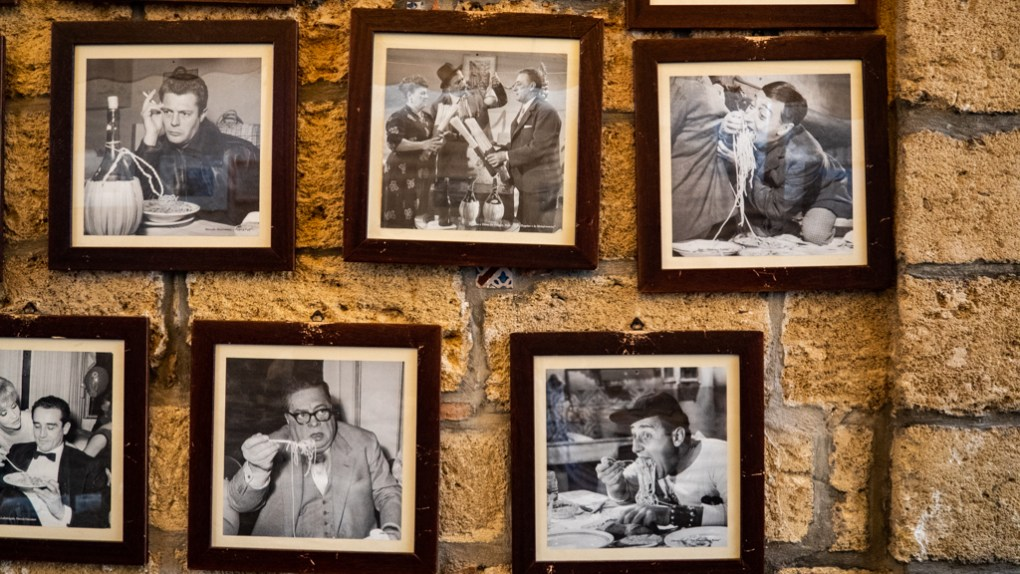 Pictures of famous Italians outside Al Vicoletto Restaurant in Cefalù, Sicily