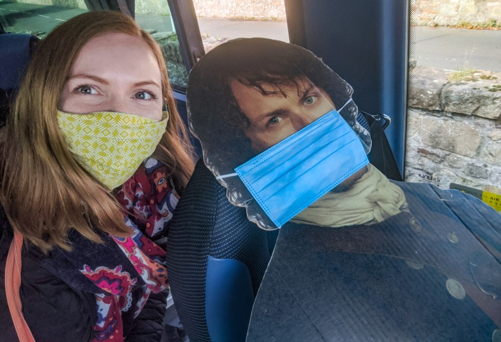 Almost Ginger blog owner wearing a face mask with a cardboard cut out of Jamie Fraser from Outlander wearing a mask