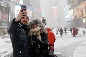 A couple takes a selfie during a snowstorm at Times Square in the Manhattan borough of New York