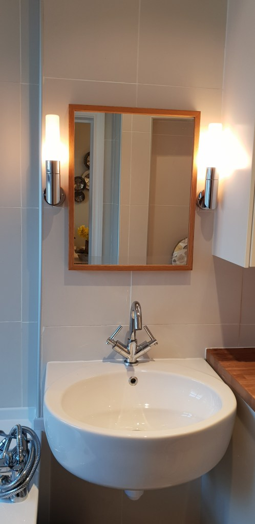 Bathroom sink with mirror and lights