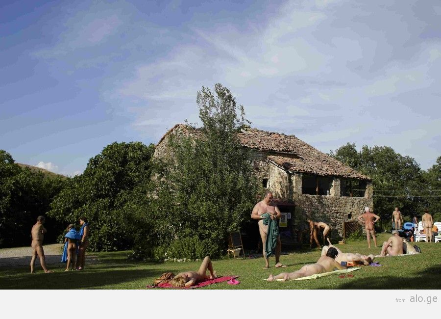 """People relax during the """"www.inudisti.it"""" web community's annual gathering on private property at Oasis of Zello naturist resort near Bologna"""